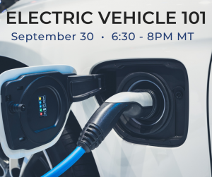 Electric charger plugged into car with EV 101 workshop details